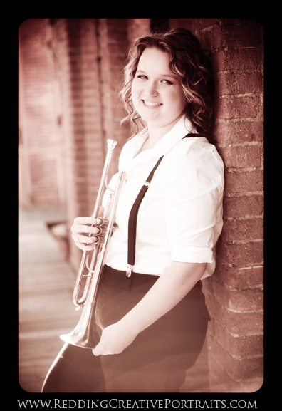 senior photo with trumpet